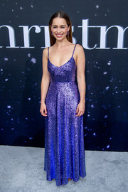 Emilia Clarke looked appropriately festive in a purple sequined gown by Valentino at the New York premiere of 'Last Christmas.'