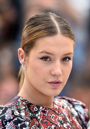 Adele Exarchopoulos sported a neat, center-parted ponytail at the Cannes photocall for 'The Last Face.'