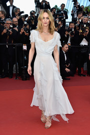 Vanessa Paradis styled her dress with strappy gold sandals by Jimmy Choo.