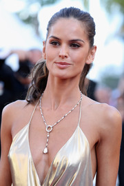 Izabel Goulart opted for a simple wavy ponytail when she attended the Cannes premiere of 'The Last Face.'