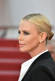 Charlize Theron slicked her hair back into a twisted bun for the Cannes premiere of 'The Last Face.'