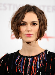 Keira wears a beautiful raspberry toned lipstick.