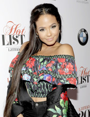 Christina Milian styled her super-long locks into a center-parted half-up 'do for Latina's 20th anniversary celebration.
