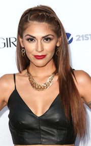 Melissa Barrera contrasted her edgy outfit with a youthful partially braided hairstyle during the Hollywood Hot List party.