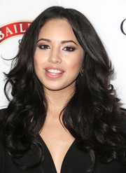 Jasmine Villegas styled her hair in a cascade of curls for the Hollywood Hot List party.
