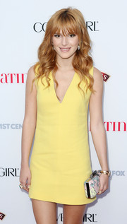 Bella Thorne avoided a monotonous look by pairing a printed clutch by Diane von Furstenberg with her plain yellow dress.