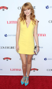 Bella Thorne sported a lovely mix of colors at the Hollywood Hot List party with this yellow Fausto Puglisi mini dress and aqua pumps combo.