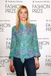 Fabia Di Drusco chose a floral blouse with puffed sleeves for her look at the Dorchester Collection Fashion Prize Launch in Milan.