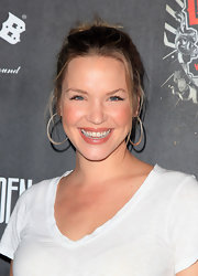 Ashley Scott punches up her look with a pair of oversized hoop earrings.