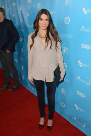 Nikki Reed opted for a loose button down blouse to keep her red carpet look natural and minimal.