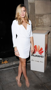 Caggie Dunlop arrived at the Huawei launch event in a pair of suede platform pumps.