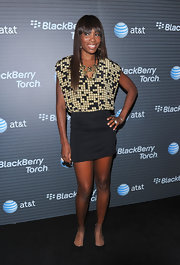 Venus paired her mini dress with a printed top and gold statement necklace.