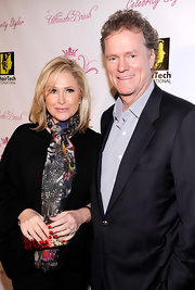 Kathy Hilton added some color to her ensemble with a patterned scarf.
