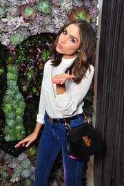 Olivia Culpo arrived for the Wildfox Loves Coca-Cola collection launch carrying a Chloe Drew suede and leather cross-body bag.