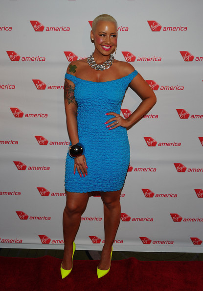 Amber Rose arrived at Virgin America's launch of the LA to Philadelphia flight wearing a pair of neon pumps.