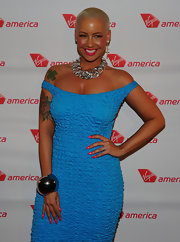 Amber Rose gave both her lips and nails touches of bright pink for the Virgin America flight to Philadelphia launch.