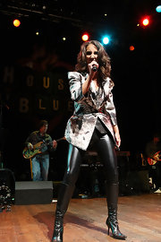 Laura performed on stage in knee high heeled leather boots.