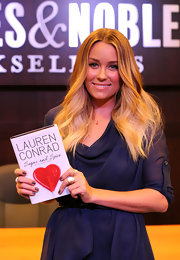 Reality TV star, designer, and author Lauren Conrad wore an  18-karat yellow gold pave panther ring