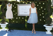 Nude heels keep Lauren Conrad's feminine ensemble the star of the show.