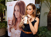 Lauren Conrad drinks a glass of milk in baby blue nail polish.