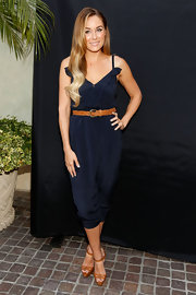 Lauren showed off one of the hottest trends of the summer, the jumpsuit. She paired her look with tan sandals and a matching belt.