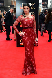A red floral gown with a scalloped neckline was Idina's look of choice at the Laurence Olivier Awards in London.