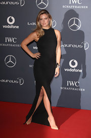 Bar Refaeli looked ultra-sexy in this black gown with a thigh-high slit at the Laureus World Sports Awards.