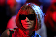 Even in dim lighting, Anna Wintour's iconic bob is easily recognizable!