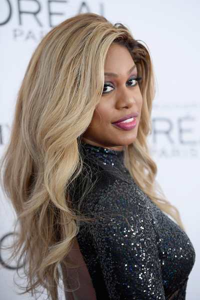 Laverne Cox Long Wavy Cut [hair,blond,hairstyle,face,long hair,hair coloring,eyebrow,lip,beauty,layered hair,arrivals,women of the year awards,laverne cox,brooklyn,new york,kings theatre,glamour,glamour celebrates 2017 women of the year awards]