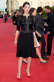 Astrid Berges-Frisbey dressed in a classic black knee-length skirt at the 'Lawless' red carpet premiere.