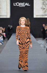 Jane Fonda stole the show in a tiger-patterned suede dress by Balmain when she walked the Le Defile L'Oreal Paris runway.