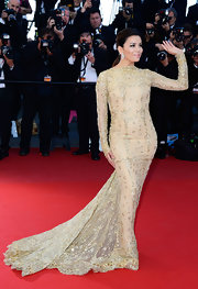 Eva Longoria stunned in a golden lace embellished gown while at the premiere of 'Le Passe' at the Cannes Film Festival.