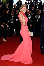 Hofit Golan looked lovely in a strapless pink dress that featured a feathered neckline and a mermaid skirt.