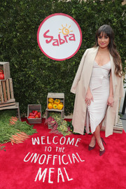 Lea Michele layered a nude AYR coat over a structured white dress for the Sabra Unofficial Meal event.