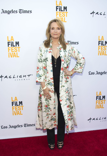Lea Thompson Printed Coat [the la film festival opening night world premiere of focus features,the book of henry,photo,clothing,carpet,red carpet,fashion,premiere,flooring,outerwear,fashion design,long hair,dress,lea thompson,culver city,california,auto sponsorship,alfa romeo,laff,afp]