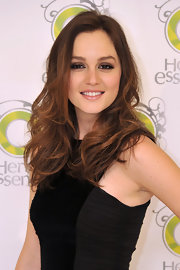 Leighton Meester smiled for the cameras as she showed off her relaxed tousled curls. We love Leighton's brunette shade, it's perfect for the fall season.
