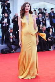 Eleonora Carisi donned a yellow satin halter gown by Alberta Ferretti Couture for the Venice Film Festival premiere of 'The Leisure Seeker.'
