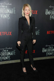 Kelly Ripa went sleek and stylish in a black tuxedo jumpsuit at the screening of 'Lemony Snicket's A Series of Unfortunate Events.'