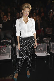 Sylvie van der Vaart looked like a classic beauty in a white button-down shirt with pintucked sleeves.