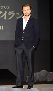Leo looked effortlessly cool in a navy blazer over a white shirt and gray slacks.