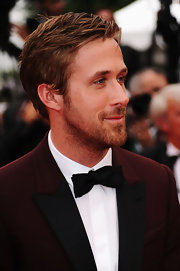 Ryan Gosling looked adorable in his black bowtie as he flashed a semi-smile to his screaming fans.