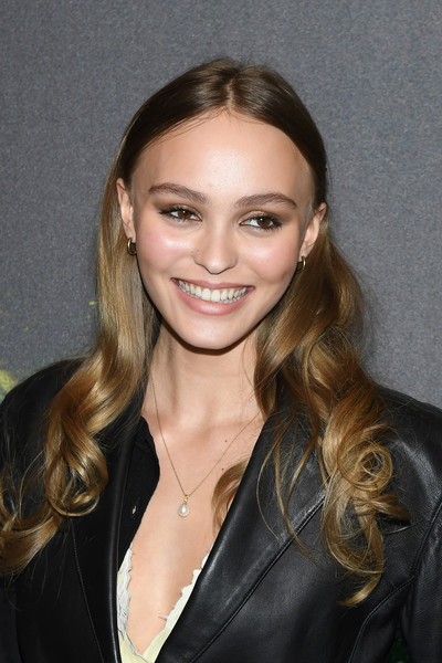 Lily-Rose Depp accessorized with a classic pearl pendant.