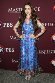 Lily Collins complemented her dress with a pair of blue satin platforms.