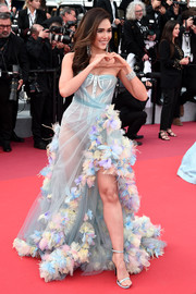 Araya Hargate worked a sheer, flower-appliqued corset gown by Atelier Versace at the 2019 Cannes Film Festival screening of 'Les Miserables.'