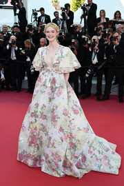Elle Fanning looked downright darling in a floral-embroidered princess gown by Valentino Couture at the 2019 Cannes Film Festival screening of 'Les Miserables.'