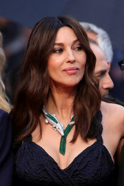 Monica Bellucci framed her face with a center-parted wavy 'do for the 2019 Cannes Film Festival screening of 'Les Plus Belles Années d'une vie.'