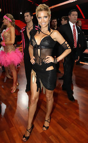 Sylvie looked fierce in a cutout, dance costume with feathered, dangling earrings.