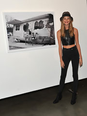 Behati Prinsloo showed off her slim legs in black skinny jeans at the 'Letters to Haiti' premiere.