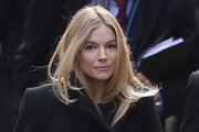 Sienna Miller looked lovely with long, wind-swept hair while in London.