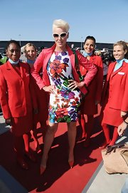 Brigitte Nielsen looked feminine and chic in this bold floral print day dress!